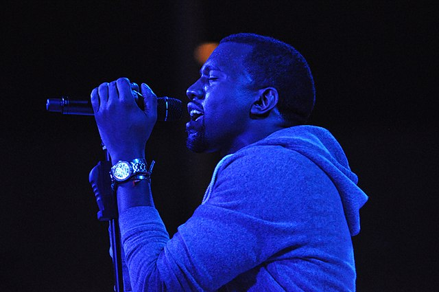 Kanye West singing into a mic  https://commons.wikimedia.org/wiki/Main_Page