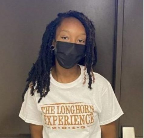 Student wears the shame shirt that students who get dress coded have to wear